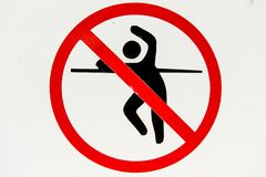 No trespassing and fence jumping danger sign Royalty Free Stock Photography