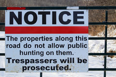 No Trespassing or Hunting Sign on a Gate Royalty Free Stock Image