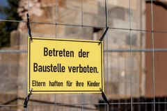 No Trespassing. Parents are responsible for their children. German warning sign. No Trespassing. Parents are responsible for their children Royalty Free Stock Photos