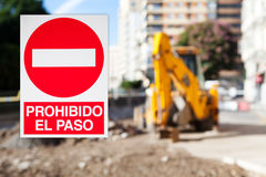 No Trespassing poster in spanish. Work zone background. Stock Images
