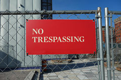 No Trespassing. A red No Trespassing sign on a fence Royalty Free Stock Images