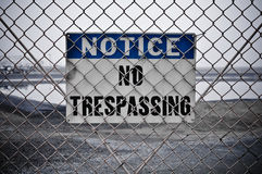 No Trespassing Sign. Dingy No Trespassing Sign in Front of Protected Area Stock Image