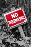 No trespassing sign. Bright red restriction sign in forest Royalty Free Stock Photos