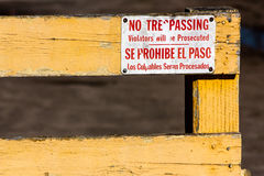 No Trespassing Sign. Worn No Tresspassing, Violators will be Prosecuted in English and Spanish Royalty Free Stock Photography