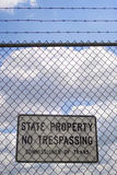 No Trespassing Sign. A no trespassing sign that reads STATE PROPERTY NO TRESPASSING outside an airport Royalty Free Stock Image