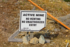 A no trespassing sign at an active mine site Royalty Free Stock Photo