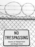 No Trespassing Sign with Barb Wire Stock Photo