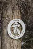 No trespassing sign with cowboy with gun Stock Photo