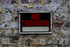 No Trespassing sign on Distressed Brick Wall Stock Images