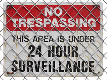 No trespassing sign. On the fence, warning about surveillance Royalty Free Stock Photos