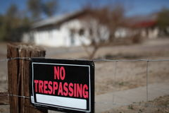 No Trespassing Sign in front of a house Stock Photography
