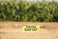 No Trespassing Sign in front of a orchard Stock Photo