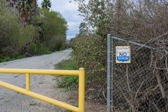 No trespassing sign at gate blocking road Stock Photos
