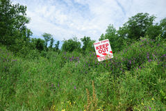 No Trespassing Sign In Field Royalty Free Stock Photo