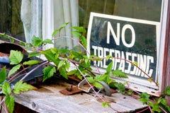 No trespassing sign at window Stock Photo