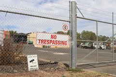 A No Trespassing and Surveillance Cameras In Use signs near the Stock Photo