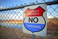 No Trespassing US Gov. Ernment Property Warning Sign on Fence Stock Photo
