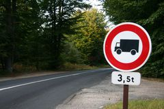 No trucks road sign. On a forest road Royalty Free Stock Photography