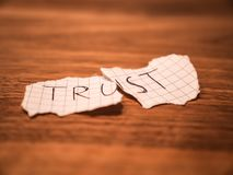 No trust teared up peace of paper on a table royalty free stock photos