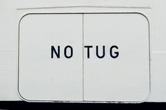 No tug warning sign on ships side Stock Photography