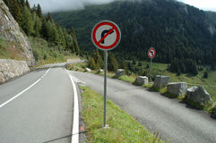 No turn signs on mountain road Stock Photo