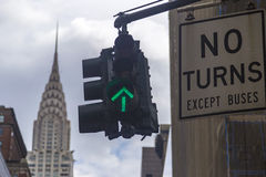 No turns road sign with green traffic light and the Chrysler building in background Stock Photos