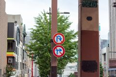 No u-turn and no right turn sign on the street in Japan. No u-turn and no right turn sign on the urban street in Japan stock image