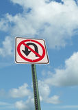 No u-turn sign on clouds Royalty Free Stock Photo