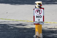No U-Turn sign on a post. In daylight royalty free stock photo