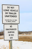 No Unattended Vehicles or Dumping Sign Along a Highway Royalty Free Stock Photo
