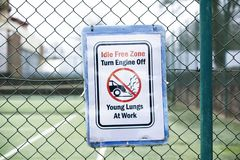 No vehicle idle idling emissions pollution young lungs at play sign outside school. Uk royalty free stock photography