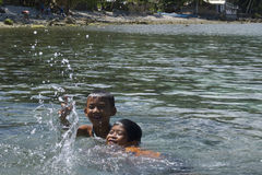 No video games here... Filipino kids having fun swimming in Leyte, Philippines, Tropical Asia. Such happy faces and warm hearts in the Philippines! The children stock photos