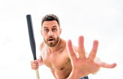 No wait. freeze. man with baseball bat. i am a criminal. Hooligan man hits the bat. Bandit gang and conflict. aggression. And anger. i doint want to fight royalty free stock image