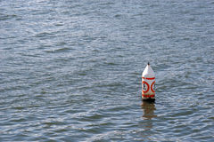 No Wake Zone. 5 MPH buoy in the Ocean royalty free stock photography