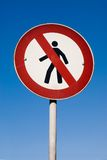 No Walking Sign against blue sky Royalty Free Stock Photo