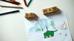 No war phrase on cubes, military situation drawing on table, political problems. Stock photo stock photo