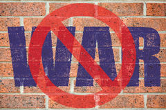No war sign painted on old red brick wall Royalty Free Stock Image