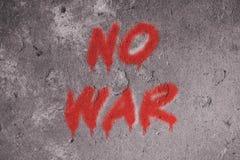 No war text graffiti on grunge wall. Sign, design, concept, background, peace, symbol, vintage, texture, message, paint, art, brick, world, wallpaper, red stock photos