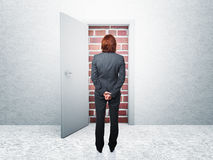 No way. Standing woman and closed door Royalty Free Stock Image
