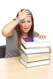 No way!. Young girl realizes how much she has to study, on white Royalty Free Stock Photography