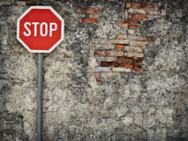 No way through. Stop sign against grungy wall, may represent protection,dead end,wrong way,resistance Stock Photo