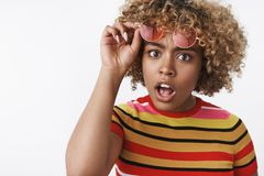 No way how can it be. Impressed and astonished questioned african american stylish woman with blond haircut raising. Eyebrows confused drop jaw and taking off stock photo