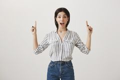 No way, I can not believe in my luck. Portrait of amazed and excited beautiful woman in striped blouse screaming from. Good surprise and positive emotions Royalty Free Stock Photo