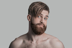 No way!. Portrait of young man looking at camera with surprised face while being in front of grey background Stock Image