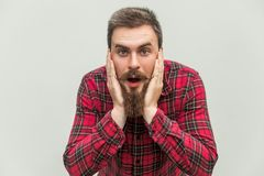 No way! Surprised young adult man with opened mouth and big eyes Royalty Free Stock Image