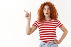 No way wow have you heard. Impressed fascinated good-looking redhead stylish girl drop jaw gasping amused smiling. Delighted wide eyes thrilled pointing upper stock photo