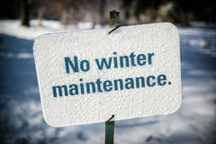 No Winter Maintenance Sign Covered in Ice Stock Image