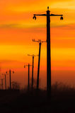 No wires on sunset. Electricity pylons over the sunset sky Royalty Free Stock Photo