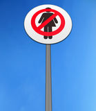No women isolated against a bright blue sky. Road sign, depicting no women isolated against a bright blue sky Royalty Free Stock Images