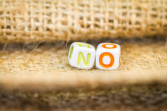 NO word cube beads on sockcloth Royalty Free Stock Image